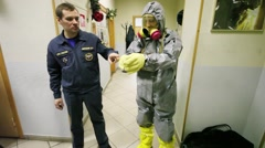 Two men show protective costume during excursion Stock Footage