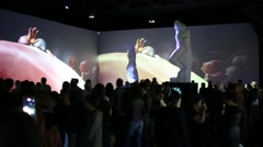 People at show in Michelangelo exhibition in Artplay Design Center Stock Footage