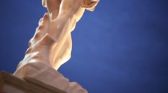 Copy of statue of David at night street in Michelangelo exhibition Stock Footage