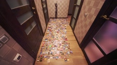 Many refrigerator souvenir magnets spread out on floor in hallway Stock Footage