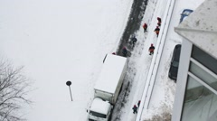 Top view of nine workers next to truck on winter day - stock footage