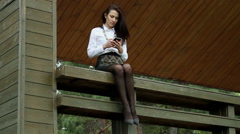 The young girl on a walk in the park talking the phone - stock footage