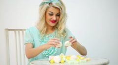 Beautiful girl with white hair holds marshmallows and tastes sweet Stock Footage