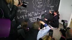 Elena Temnikova singer draws and photographers work Stock Footage