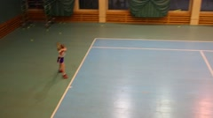 Two boy and girl playing tennis against each other Stock Footage