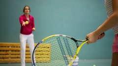 Hands of girl learning to hold racket and beat off balls Stock Footage