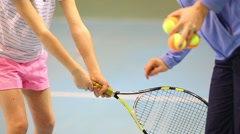 Hands of coacher training to girl to hold racket. Focus on child Stock Footage
