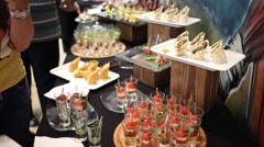 Canapes cold dishes and hands of people taking food Stock Footage