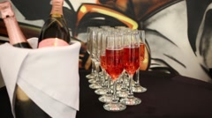 Glasses with Sparkling rose wine and bottles in ice bucket Stock Footage