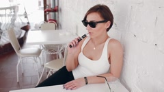 girl with the electronic cigarette - stock footage
