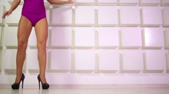 Woman in bodysuit and shoes with heels on white chair spinning Stock Footage