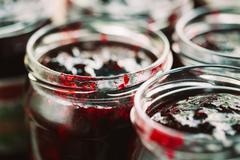 Jars With Sweet Tasty Yummy Red Jam - stock photo