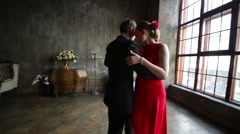 Close up of woman in red dress and man in black suit dancing tango Stock Footage