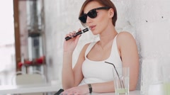 Girl with the electronic cigarette Stock Footage