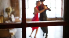 Young couple dance tango behind window out of focus Arkistovideo