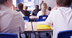 4k, Two students passing notes during a class. Stock Footage