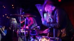 Young drummer performs at concert in night club, video with sound Stock Footage