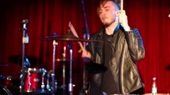 Drummer performs on stage in night club, video with sound Stock Footage