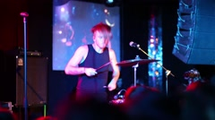 Drummer performs at concert in modern night club, video with sound Stock Footage