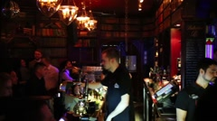 People rest in bar in 16 Tons night club at concert T-killah Stock Footage