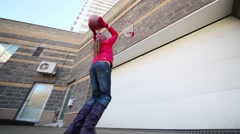 Under view of girl and boy playing basketball outdoor Stock Footage