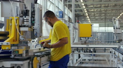 Factory worker preparing his machine Stock Footage