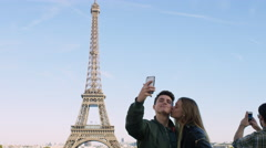 Couple visiting the Eiffel tower and taking selfies with each other. Stock Footage