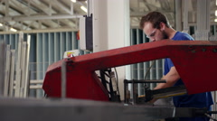 Factory worker using machines while at work Stock Footage