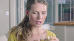 Lady taking a sip of Herbal tea while at home. Stock Footage