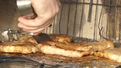 Hand Using Tongs For Turning Meat on the Grill. Stock Footage