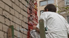 Artist draws on the wall Stock Footage