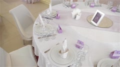 Decorated table for a wedding dinner, beautiful table setting - stock footage