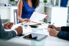 Cropped image of female entrepreneur explaining business strategy Stock Photos