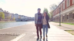 Young couple taking a romantic walk in Paris Stock Footage