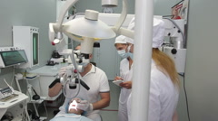 Dentist and periodontal doctor trained intern the details work with the client Stock Footage