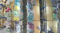 Goods on shelves at big textile warehouse. Aerial view from above Stock Footage