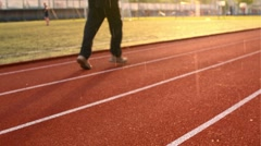 Sportsmans Running on the Stadium at the Evening Rain. Sport Background Stock Footage