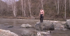 The fall of man-karateka in a mountain river Stock Footage