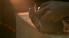Carpenter polishing wood using electric grinder with polishing extender. Stock Footage