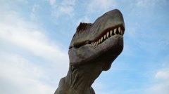 Tyrannosaurus rex life-size model in entertainment dino park Stock Footage