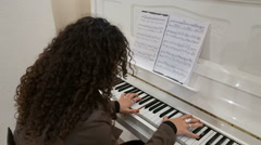 young lady plays on piano - stock footage