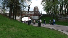 The historical Park Tsaritsyno. Fancy bridge. People. Stock Footage