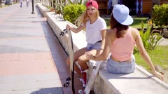 Excited beautiful skater friends near beach Stock Footage