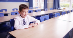 4k, Naughty young student smiling at camera during detention. Stock Footage