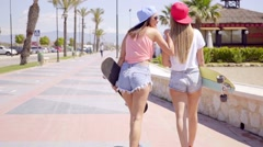 Young friends in shorts with skateboards Stock Footage