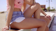 Lower half of two beautiful friends in shorts Stock Footage