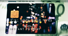 "Bank plastic card with caption ""Instant payment"" flies over banknotes counting m - stock footage"