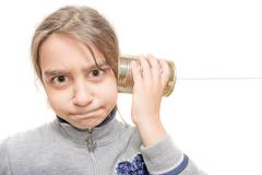 child worried hears from the phone built with the tin - stock photo