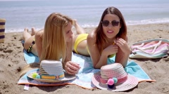 Two young women in bikinis enjoying the beach - stock footage