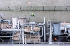 Overhead view of pipework under repair in gas-fired power station - stock photo